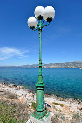Rock Photograph - Lamp Post By The Seaside by George Atsametakis
