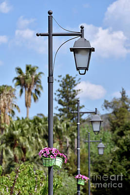 Photograph - Lampost With Flowers In Nafplio Town by George Atsametakis