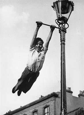 Children Only Photograph - Lamppost Tarzan by John Drysdale