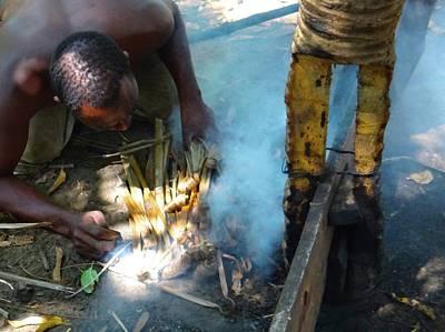 Exploramum Wall Art - Photograph - Lamu Island - Man Breathe Life Into A Fire 3 by Exploramum Exploramum