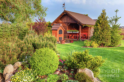 Photograph - Landscaped Summer Garden With Barbecue And Wooden Summerhouse Green Trees, Flowerbeds, by Michal Bednarek