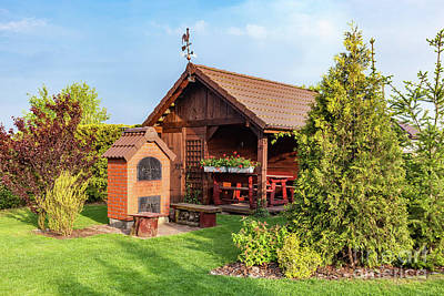 Photograph - Landscaped Summer Garden With Barbecue And Wooden Summerhouse by Michal Bednarek
