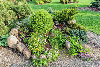 Lawn Photograph - Landscaped Summer Garden With Green Plants, Rocks, Flowers In Flowerbeds, Mown Grass. by Michal Bednarek