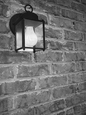 Lantern On Brick Wall  Art Print by Nicole Aponte