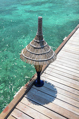 Photograph - Lantern On Wooden Jetty Over Blue Water by Jenny Rainbow