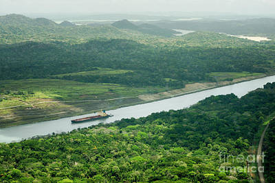 Exotic Photograph - Large Cargo Ship Navigating Through The Panama Canal by Dani Prints and Images