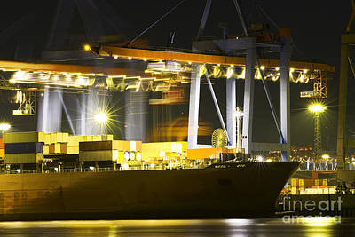 Sunset Photograph - Large Container Ship In A Busy Dock At Night by Dani Prints and Images