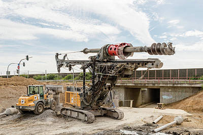 Photograph - Large rotary drill and excavator on construction site by Frank Gaertner