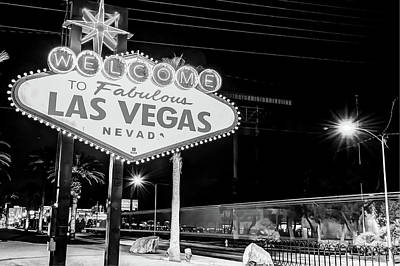 Photograph - Las Vegas Welcome Sign Lights In Black And White by Gregory Ballos
