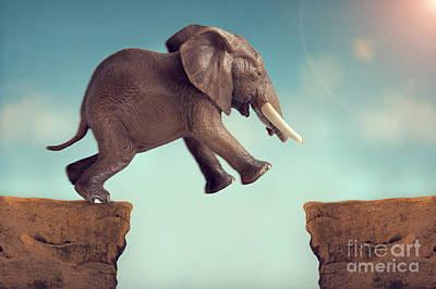 Predicament Photograph - Leap Of Faith Concept Elephant Jumping Across A Crevasse by Lee Avison