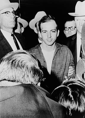 Lee Harvey Oswald Escorted By Officers Print by Everett