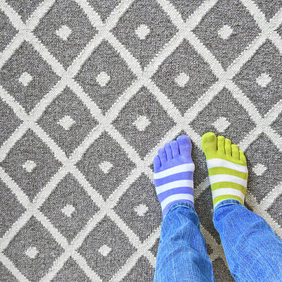 Young Woman Photograph - Legs In Mismatched Socks On Gray Carpet by GoodMood Art