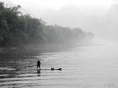 Photograph - Li River Raftman by Joe Bonita