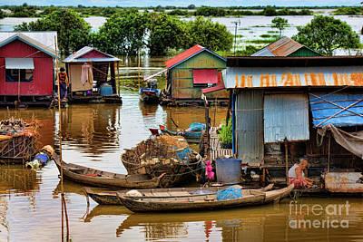 Life On Tonle Sap River  Art Print by Chuck Kuhn