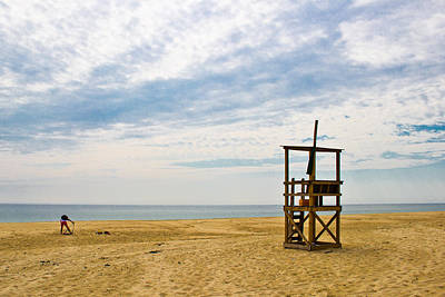 Blue Hues - Lifeguard Prepares for Duty on a Cape Cod beach by Lynne Albright