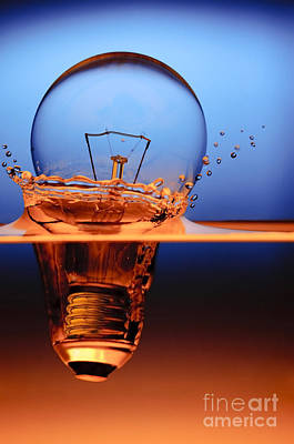 Modern Feathers Art - Light Bulb And Splash Water by Setsiri Silapasuwanchai