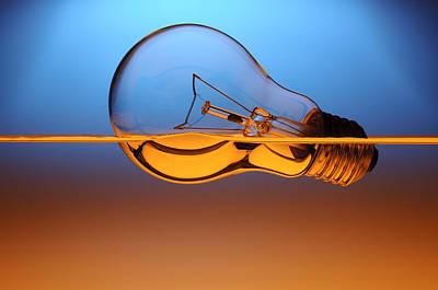 Glass Art Photograph - Light Bulb In Water by Setsiri Silapasuwanchai