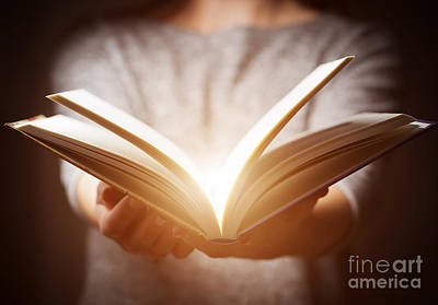 Person Photograph - Light Coming From Book In Woman's Hands In Gesture Of Giving by Michal Bednarek