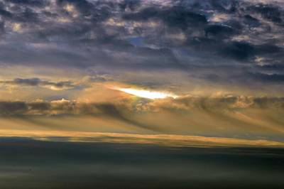 Photograph - Light In The Cloud  by Lyle Crump