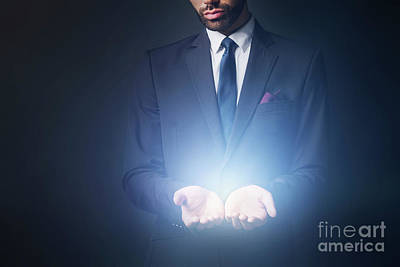 Photograph - Light Radiating From Businessman Hands by Michal Bednarek