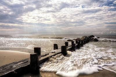 Photograph - Light Shining Down On Folly Beach Pilings Charleston South Carolina by Carol Montoya