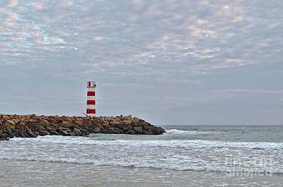 Photograph - Light Tower And Rocks In Ilha Deserta, Algarve by Angelo DeVal