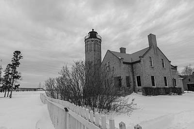 Print featuring the photograph Lighthouse And Mackinac Bridge Winter Black And White  by John McGraw