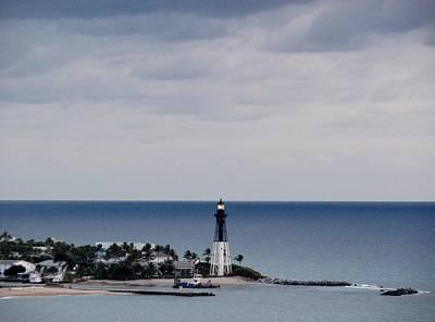 Lighthouse And Rain Clouds Art Print
