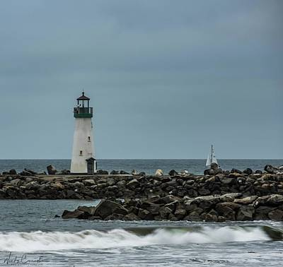 Photograph - Lighthouse And Sailboat by Wendy Carrington