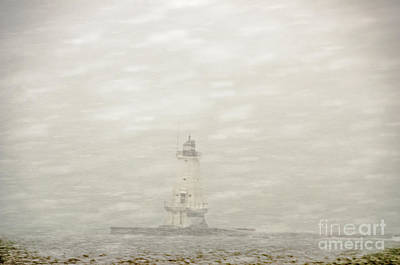 Photograph - Lighthouse In Snowstorm by Sue Smith