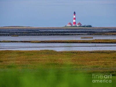 Photograph - Lighthouse In The Wadden Sea by Heiko Koehrer-Wagner