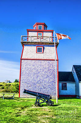 Photograph - Lighthouse With Cannon by Rick Bragan