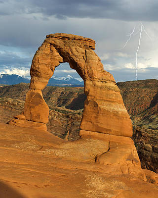 Photograph - Lightning At Delicate Arch Vertical by Aaron Spong