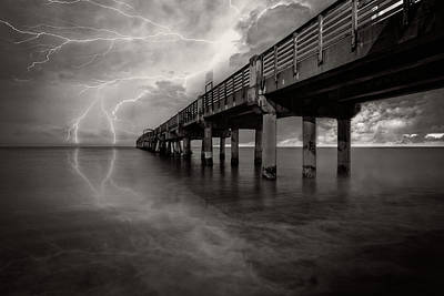 Photograph - Lightning At The Pier In Black And White by Debra and Dave Vanderlaan