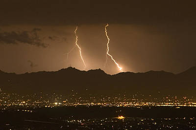 Natural Forces Photograph - Lightning Bolt Strikes Out Of A Typical by Mike Theiss