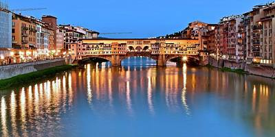 Photograph - Lights Shimmer At The Ponte Vecchio by Frozen in Time Fine Art Photography