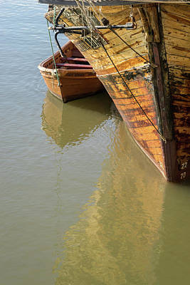 Photograph - Like Mother And Child - Old Wooden Ship And Boat Anchored Side By Side by Georgia Mizuleva