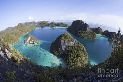 Limestone Islands Surround A Lagoon Art Print by Ethan Daniels