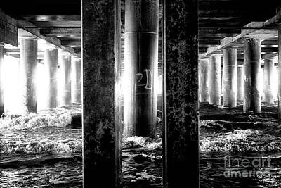 Photograph - Lined Up Under The Pier by John Rizzuto