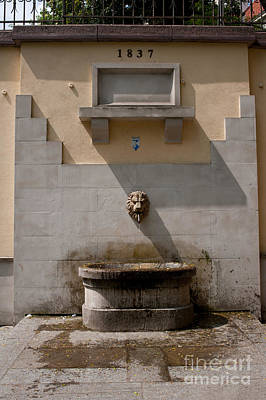Pour Photograph - Lion Head Form Fountain In Warsaw by Arletta Cwalina