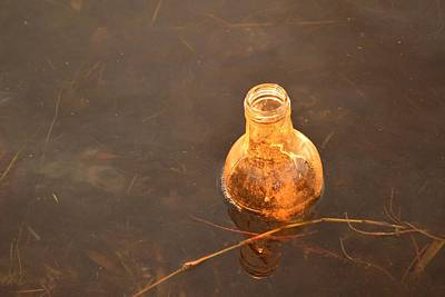 Photograph - Litter As Art - Orange Bottle by rd Erickson
