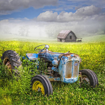 Photograph - Little Blue Tractor by Debra and Dave Vanderlaan