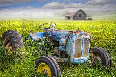 Photograph - Little Blue Tractor II by Debra and Dave Vanderlaan