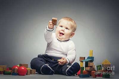 Photograph - Little Boy Handing A Wooden Brick. by Michal Bednarek