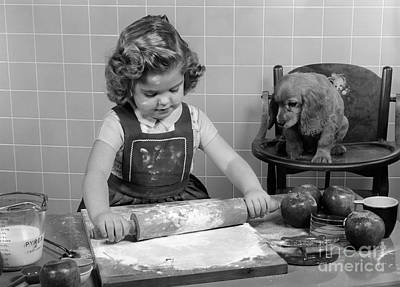 Highchair Photograph - Little Girl Baking As Puppy Looks On by H. Armstrong Roberts/ClassicStock