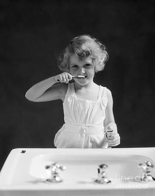 Photograph - Little Girl Brushing Her Teeth, C.1930s by H Armstrong Roberts and ClassicStock