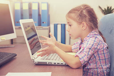 Photograph - Little Girl Doing Homework On The Laptop by Anna Om