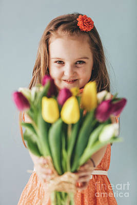 Photograph - Little Girl Giving Colorful Flowers, Smiling Sincerely by Michal Bednarek