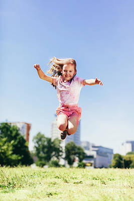 Photograph - Little Girl Jumping High In The City Park In Colorful Dirty Clothes. by Michal Bednarek
