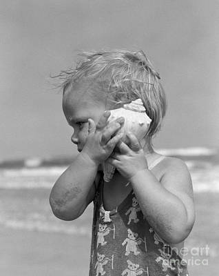 Photograph - Little Girl Listening To Seashell by H Armstrong Roberts and ClassicStock